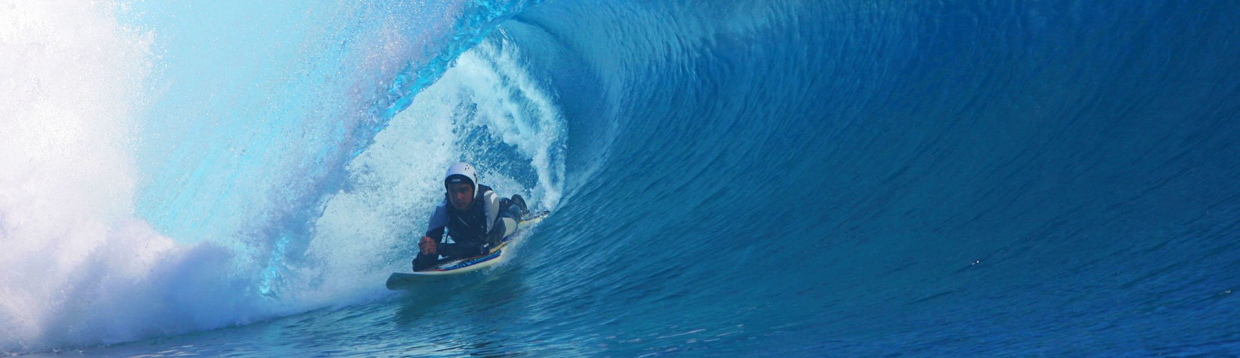 Jesse Billauer, a world champion quadriplegic surfer and inspirational speaker, riding a wave