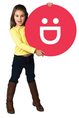 Child holding Safe Kids logo sign