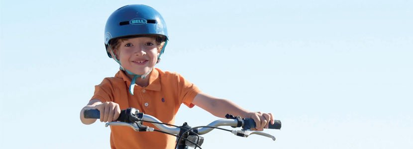 Boy smiling on a bicycle
