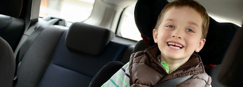 Child smiling in his car seat