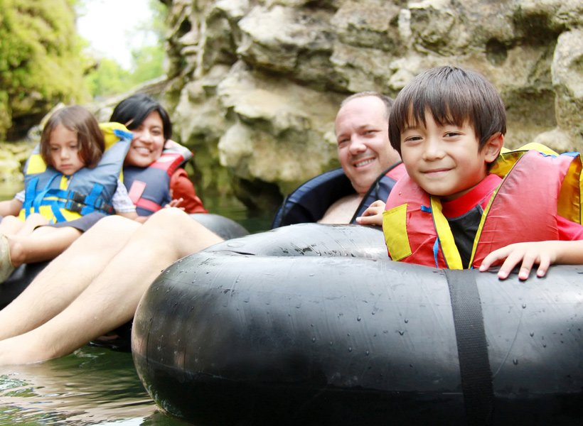 Family on inner tubes floating in the water