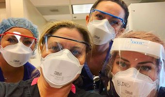 Close up photo of 4 Cottage nurses wearing personal protective equipment